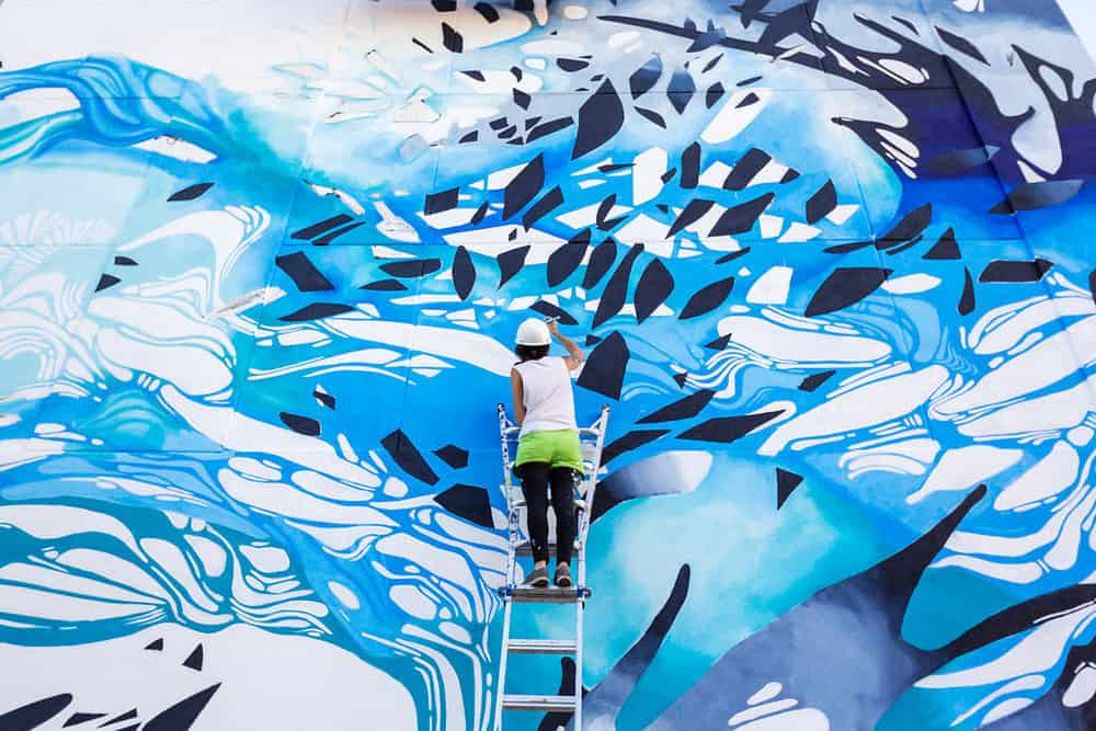 Artist Crystal Wagner creates a mural during the 2017 Harrisburg Mural Fest. (Photo by Landon Wise Photography)