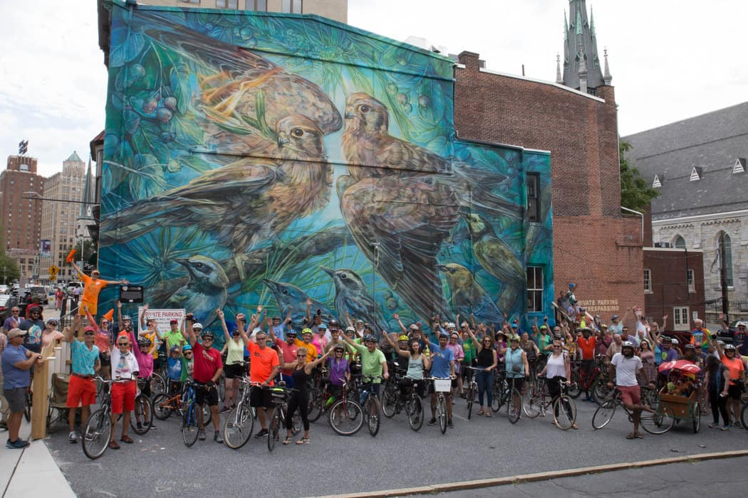 Approximately 150 people participated in the colorful bike tour around the city to see murals painted in 2017 and during this year's Harrisburg Mural Fest. The environmentally themed mural was painted by muralist Emily Ding. (Photo courtesy of Dan Davis Photography)