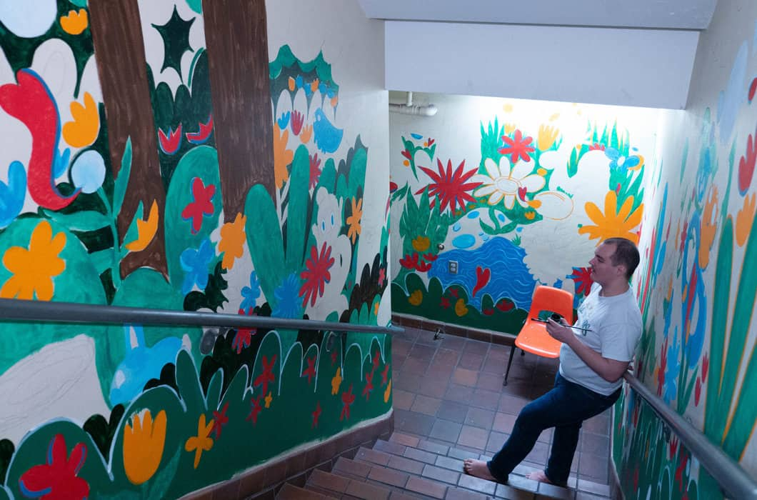 Stephen Michael Haas inspects his latest project, a mural based on themes from the biblical story of the Garden Of Eden. The mural is located in St. Stephen's Episcopal School in Harrisburg, Pennsylvania. (Photo by Bryan Speece)